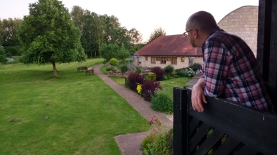 Hubby looking out from a balcony at the grounds of Martin House at several rabbits on the lawn