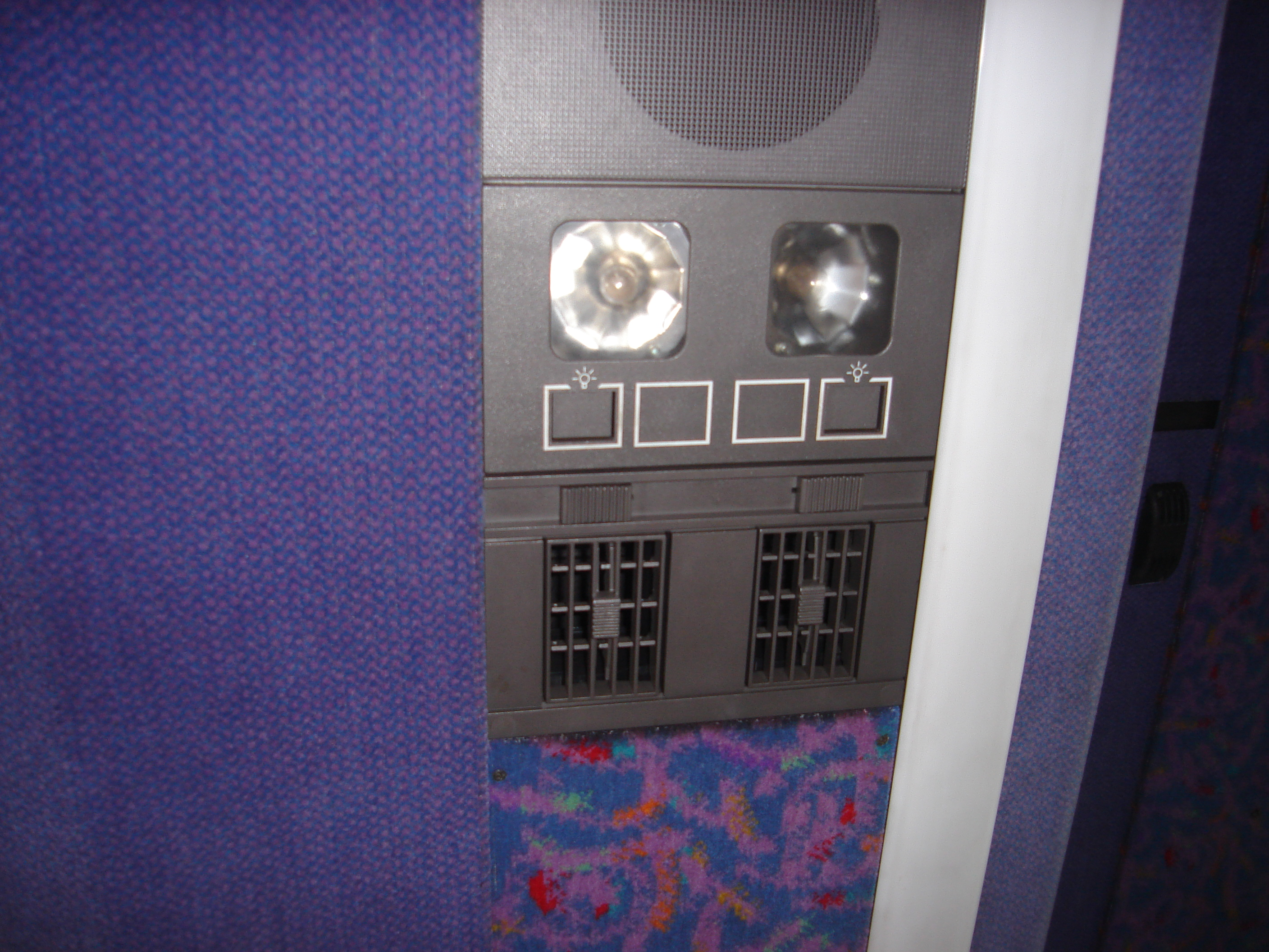Air-con vents on the ceiling of a coach